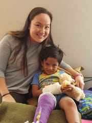 Hannah Chong, daughter of Dr. Laura Chong, helped comfort young patients in Ecuador who were treated by Capitol City Medical Teams.