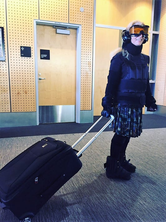 636075655757181065-Harriet-Baskas-wearing-30-pounds-of-aging-suit-apparatus-for-test-walk-through-SEA-airport.jpg