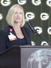 Jen McDonald of Bellin Health talks about the Packers vs. Cancer partnership Tuesday at Lambeau Field.