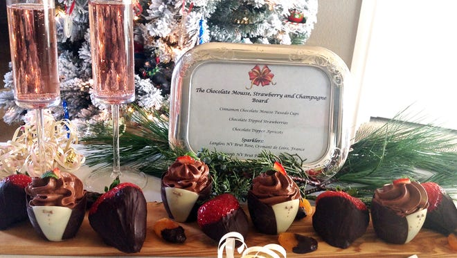 The Dessert Board features chocolate and strawberries and is accompanied by flutes of sparkling wine.