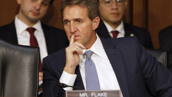 Sen. Jeff Flake, R-Ariz., received $1,000 in campaign donations from the leader of a White separatist group cited in Dylann Roof's purported manifesto before the mass shooting at a Charleston, S.C., church.