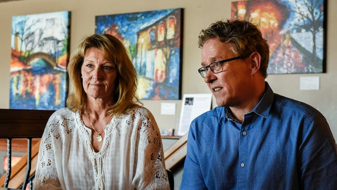 Scott & Reyne Roeder talk about their son's mental health issues surrounded by his artwork Friday, May 25, on display at Old Capital Tavern in Sauk Rapids. In February their son Jackson, 25, died by suicide.