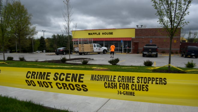 Workers prepare to re-open the Waffle House where four people were killed Sunday morning in Antioch, Tenn., Tuesday, April 24, 2018.