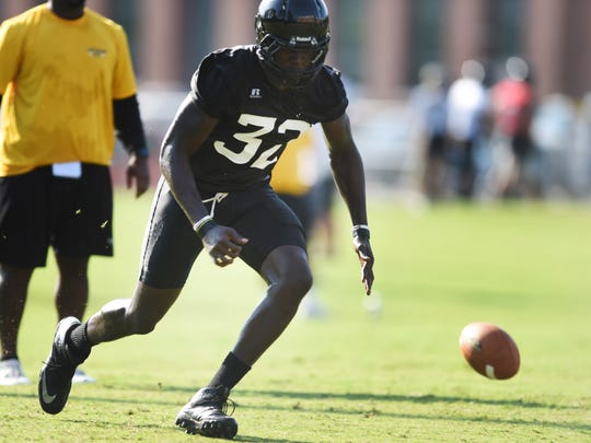 Southern Miss player Xavier Thigpen runs a drill during the fall football camp on Saturday.