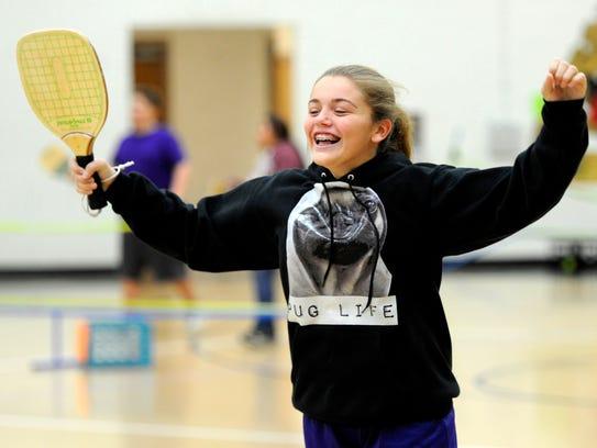 Seventh grader Jayci Pippin celebrates after winning