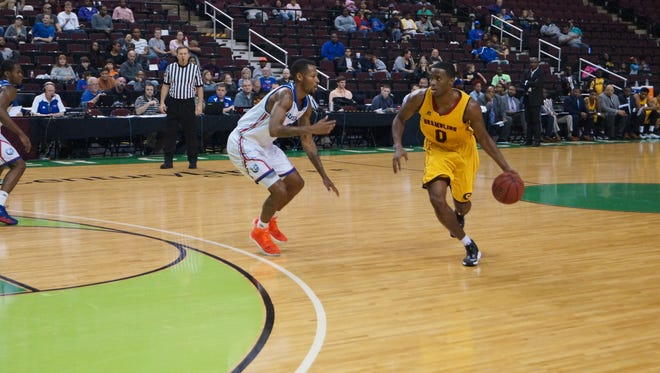 Louisiana Tech guard Jacobi Boykins, left, poured in 24 points in the Bulldogs' win over Grambling on Saturday in the Shreveport-Bossier Holiday Classic at the CenturyLink Center.
