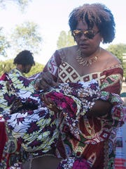 Lilly Tshibangu, of Lancaster, does her daughter's