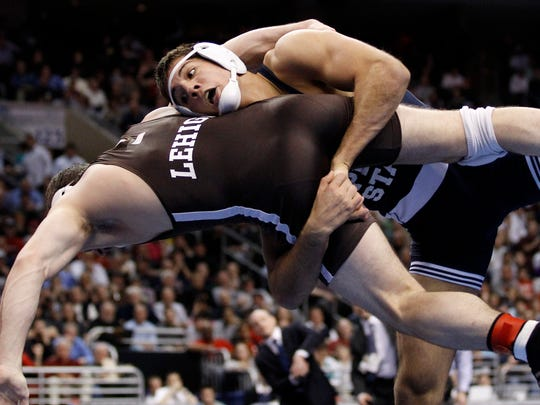 Penn State's Quentin Wright, top, who will be a speaker at the Fishburne wrestling camp in June, takes down Lehigh's Robert Hamlin during his win in the 184-pound final at the 2011 NCAA Division I Wrestling Championships in Philadelphia.