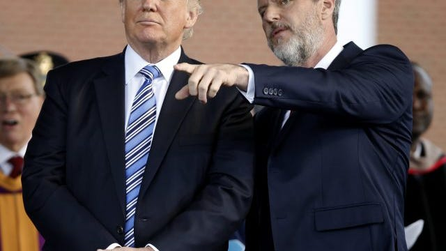 In this May 13, 2017 photo, President Donald Trump stands with Liberty University President Jerry Falwell Jr. in Lynchburg, Va.