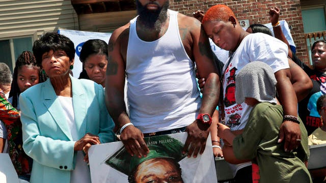 In this Aug. 9, 2019 file photo, Cal Brown stands with her husband Michael Brown Sr. during a memorial program for Michael Brown Jr., fatally shot by a police officer, in Ferguson, Mo. A wave of police killings of young black men in 2014 prompted 24 states to quickly pass some type of law enforcement reform, but many declined to address the most glaring issue: police use of force. Six years later, only about a third of states have passed laws on the question.