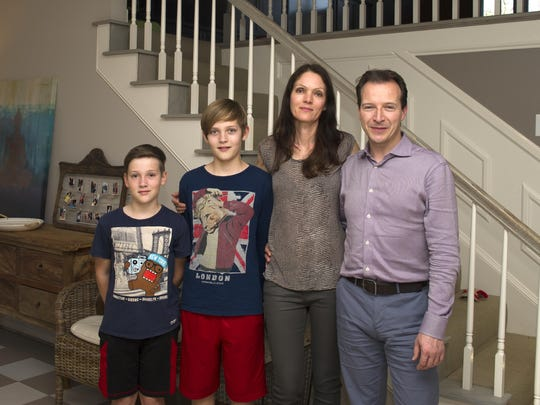 Jonah Moffett, Dylan Moffett, Nina Moffett and Julian Moffett stand inside their home in Nashville. The Moffetts are among a growing number of homebuyers arriving in Middle Tennessee from other states and other countries.