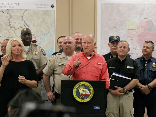 Gov. Jerry Brown on Saturday holds a press conference at the Carr Fire Incident Command Post at the Shasta District Fairgrounds in Anderson.