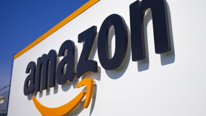 "The Amazon logo is seen in Amazon, in Douai, northern France, Thursday April 16, 2020. Amazon has decided to suspend ""temporarily"" all activity in France, one day after a French court found it wasn't doing enough to protect its workers amid the virus crisis in the country.The online giant, which has six warehouses in France, said in a statement Wednesday that ""this week, we are requesting employees of our distribution centers to stay at home. On the longer term, we will evaluate the impact of that (justice) decision for them and our French logistic network."""