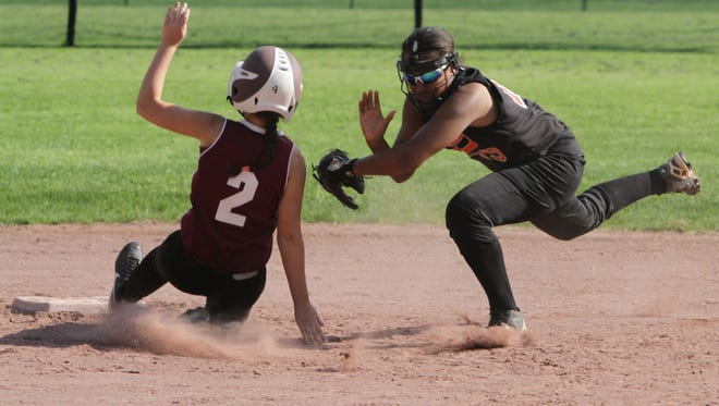 White Plains' Briana Chapman tags out pinch runner Carolina Stainfield of Scarsdale during their softball game at Supply Field in Scarsdale on Tuesday. White Plains won 7-0.