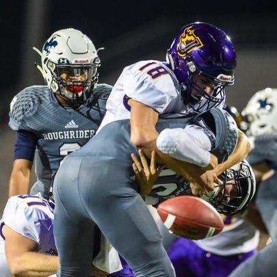 Johnston's Nathan Newcomb (18) sacks Roosevelt quarterback