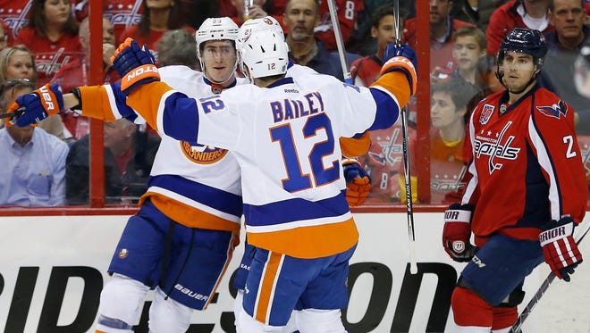 New York Islanders center Brock Nelson (29) celebrates with Islanders left wing Josh Bailey after scoring a goal against the Washington Capitals.