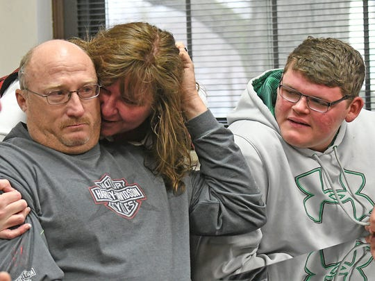 Rob Cline is emotional as he is hugged by his wife Sandy when learning he was actually in court for the adoption of his stepson, Jimmy Sprague Jr., at a hearing in Ashland County Probate Court.