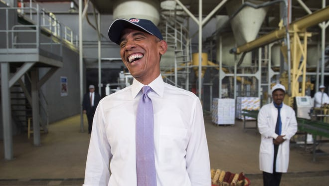 President Obama laughs at the hair nets the members of the press have to wear during a tour of Faffa Food, which produces low-cost and high-protein foods, with the help of Feed the Future in Addis Ababa on July 28, 2015. Feed the Future, Obama's global hunger and food security initiative, invests in agriculture to spur economic growth and reduce poverty and hunger.