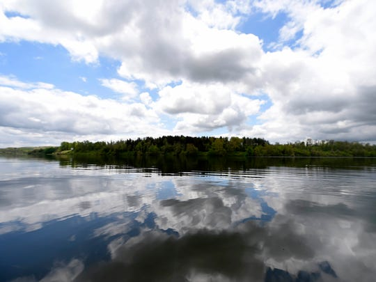 Clouds are reflected in the glassy water on Lake Redman.