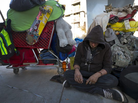 Michael Againeses, 39, is still living on Roosevelt Row after the City of Phoenix says it is illegal. January 4, 2018.