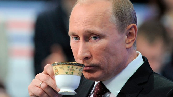 "Russian Prime Minister Vladimir Putin drinks tea during a national call-in TV show in Moscow, Russia, Thursday, Dec. 15, 2011. Putin said Thursday the results of Russia's parliamentary election reflected the people's will, and that the opposition had alleged vote fraud purely to strengthen its position. ""The results of this election undoubtedly reflect the real balance of power in the country,"" he said. ""It's very good that United Russia has preserved its leading position."" He added that a drop in support for his party was a natural result of the global financial crisis of 2008 that has taken its toll on the country.(AP Photo/RIA Novosti, Alexei Druzhinin, pool)"