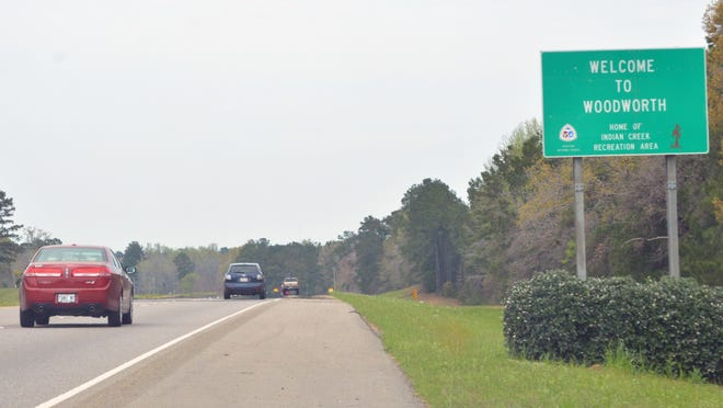"Traffic travels along U.S. Highway 165 into Woodworth in March 2014. The case of a woman stopped by a Woodworth police officer has been sent back to a trial court, but only so it can determine how much in court costs the town must pay for what it deemed an ""illegal stop"" that saw the woman spend 25 days in jail and quit her job for fear of traveling through the town."
