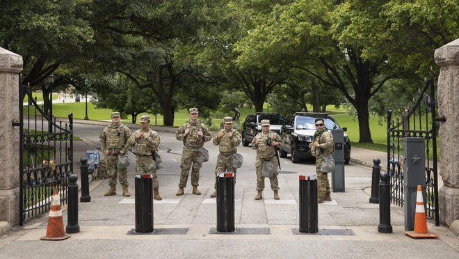 Texas Army National Guard soldiers guard the Texas State Capitol in Austin on June 2, following several days of protests in the city against police brutality and racism.