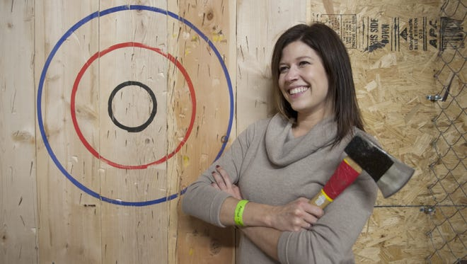 Kara Shore of Cherry Hill stands near the target while visiting Urban Axes in Philadelphia.