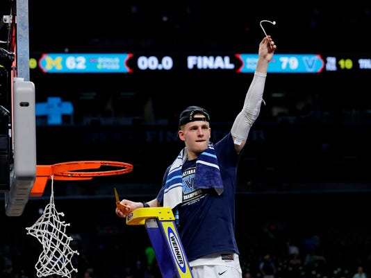 Villanova's Donte DiVincenzo cuts the net as he celebrates after the championship game of the Final Four NCAA college basketball tournament against Michigan, Monday, April 2, 2018, in San Antonio. Villanova won 79-62. (AP Photo/David J. Phillip)