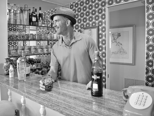 This black and white image emphasizes the retro feel of the built-in bar, one of the features Scott Cole chose to keep when remodeling the home.