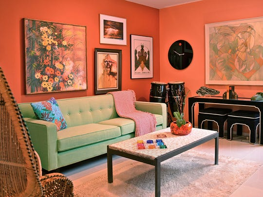 Most of the furniture in the home is vintage, including this Hendrik Van Keppel coffee table in the coral-colored den. The sofa is new.