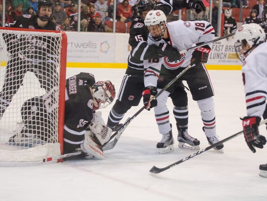 St. Cloud State's Judd Peterson tries to stuff the