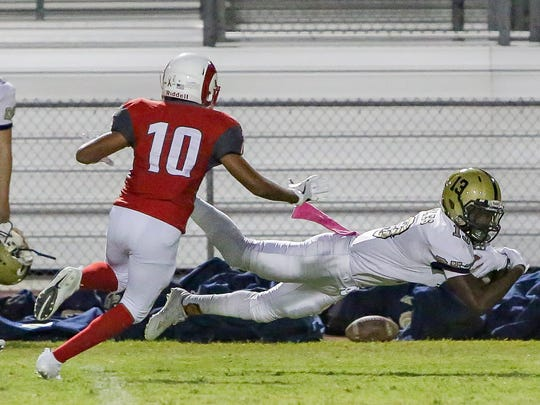 Joziaha Winfrey catches a long pass and was able to maintain possesion of the ball. The Desert Mirage varsity football team won Friday's home conference game against Desert Hot Springs by a score of 35-27.