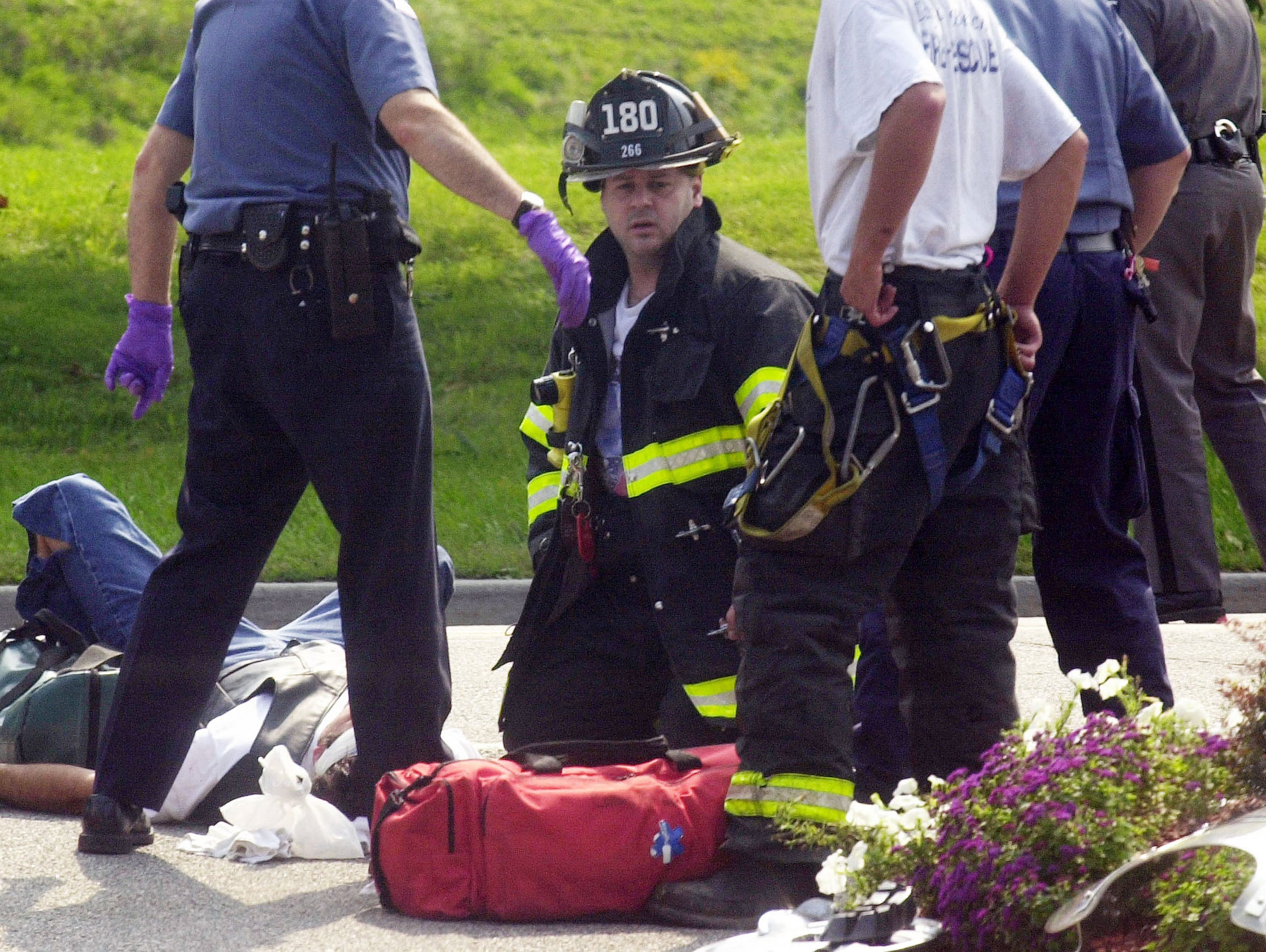 Somers firefighter Paul Jockimo tends to the victim