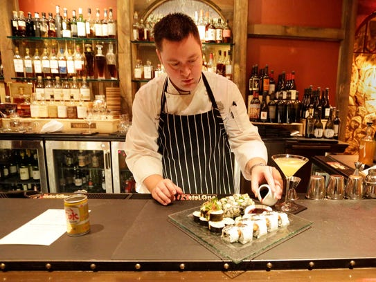 Food and Beverage Manager Matt Bauer prepares a plate