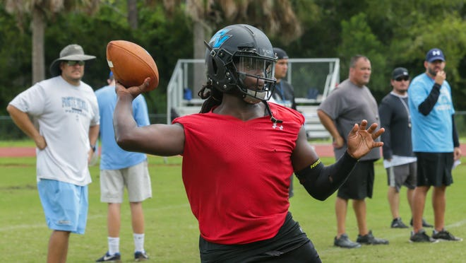 Ponte Vedra's coaching staff looks on as quarterback Cobi Myers delivers a pass on the first day of fall workouts in 2019. Myers, who is coming off an achilles injury, may not be able to return to the field until mid-August if the Florida High School Athletic Association accepts a proposal from its Fall Sports Task Force.