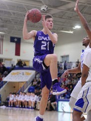 Wylie's Dylan Isenhower (21) goes up for a shot during