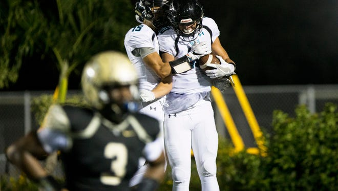 Gulf Coast wide receiver Carson Genal (10) celebrates with his teammate after scoring a touchdown at Golden Gate High School on Friday, Nov. 4, 2016. The Sharks defeated the Titans 28-7.