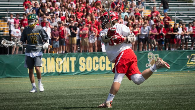 James Bernicke tallies for CVU during the 2018 Division I boys lacrosse final.