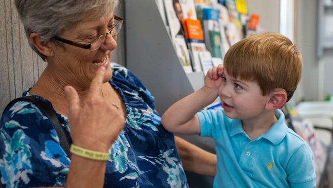 Hunter Faucheaux, 2, signs to his grandmother Melanie Evans while waiting for a speech therapy session in Breaux Bridge, LA, Wednesday, Aug. 28, 2013. Faucheaux was born deaf and suffers from a genetic disorder known as Usher syndrome . Paul Kieu, The Advertiser