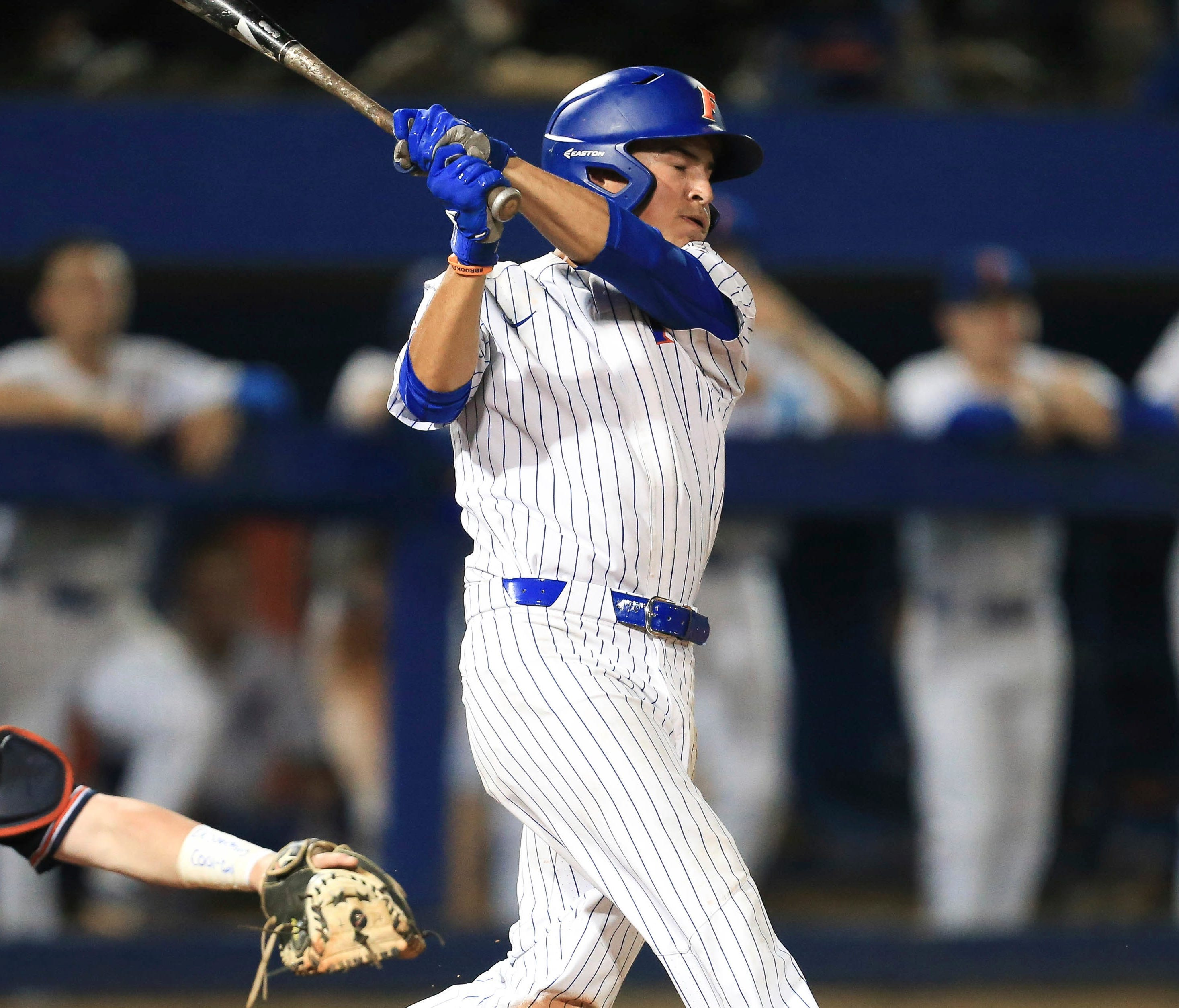 Austin Langworthy connects on the game-winning homer that sent Florida to its fourth straight College World Series.