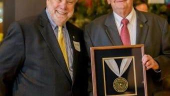 South Carolina Commerce Secretary Bobby Hitt, left, presents the first Secretary of Commerce's Award for Economic Development to Marvin Moss, longtime director of economic development in Laurens County.