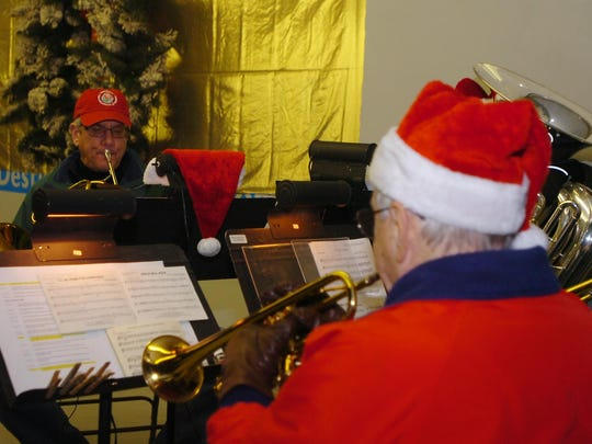 The Birmingham Brass Quintet performed at the tree lighting ceremony at Shain Park.