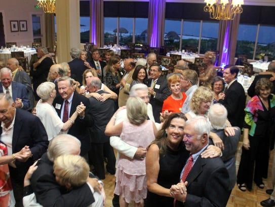 A merry crowd enjoyed the dance music of Rosetta Stone.