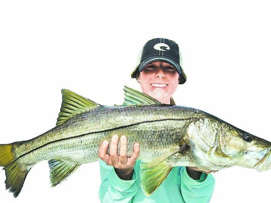 Fort Myers High senior Maddie Wise released this 33-inch snook, and its twin, fishing mangrove points in Pine Island Sound last week with Flats Fish'r Charters Capt. Blake Matherly.