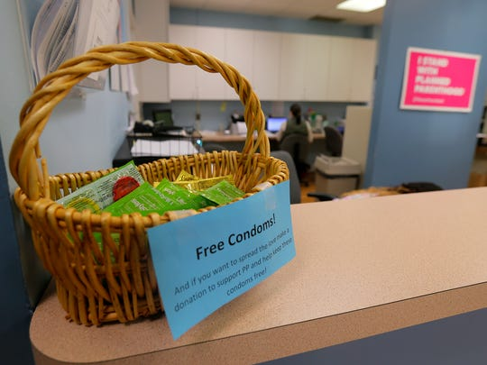 A basket of free condoms sits on the counter in the front lobby of Planned Parenthood in Shrewsbury, NJ Friday March 24, 2017.