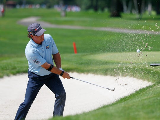 Scott McCarron chips out of a bunker during the final