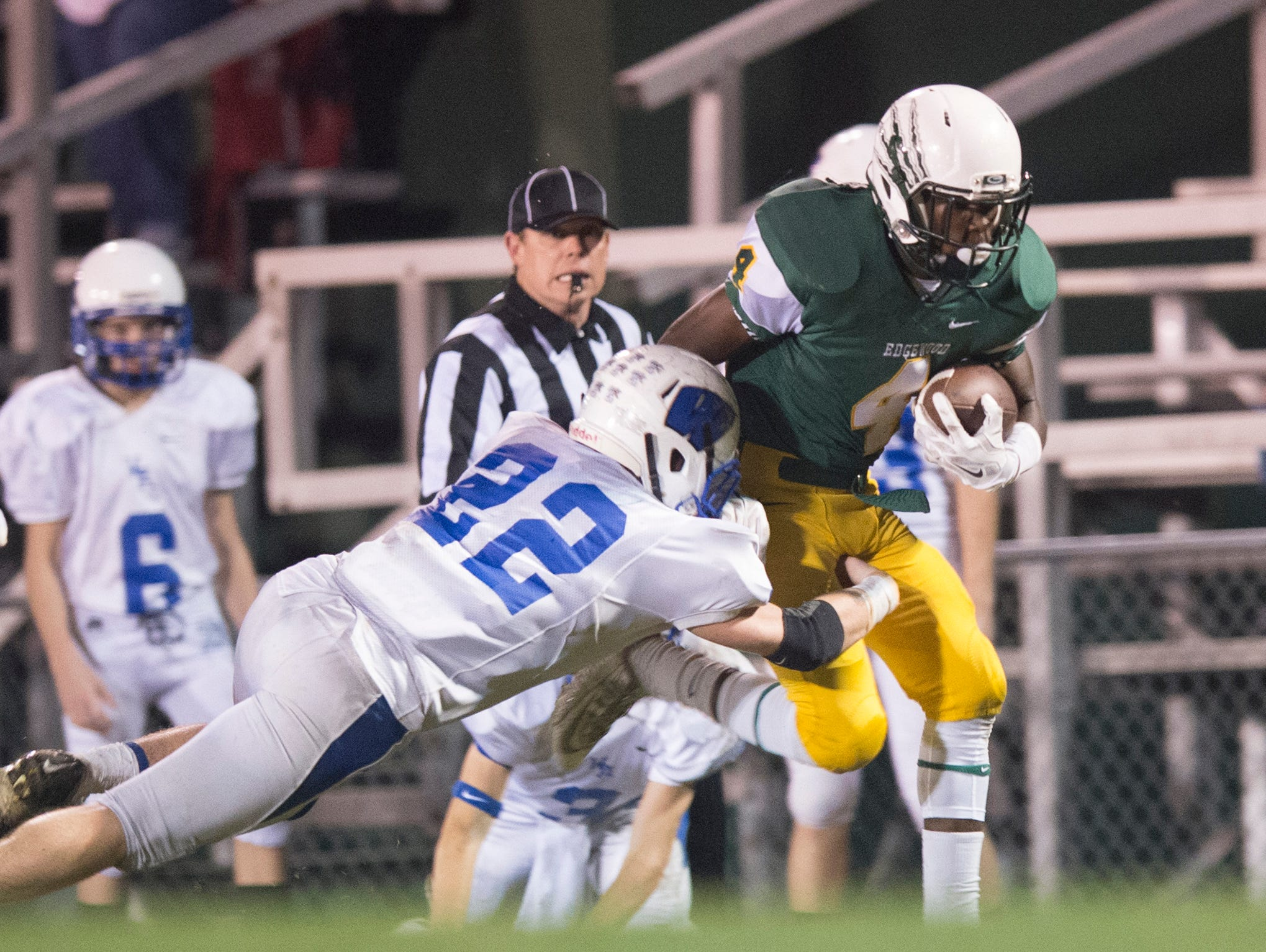 Edgewood's Maurice Young (4) breaks a tackle attempt by Wilcox's Russ Swanner (22) during the AISA playoff football game at Edgewood Academy on Thursday, Nov. 5, 2015.