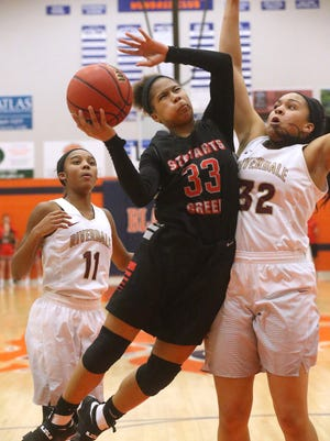 Stewarts Creek's Brandi Ferby (33) goes up for a shot as Riverdale's Brinae Alexander (32) guards her on Monday, Feb. 20, 2017, during the championship game of the 7-AAA Tournament. Riverdale's Aislynn Hayes (11) watches in the background.