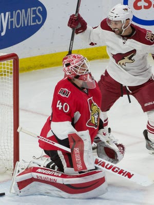 Jan 31, 2015; Ottawa, Ontario; Arizona Coyotes center Sam Gagner (9) scores against Ottawa Senators goalie Robin Lehner (40) in the third period at the Canadian Tire Centre.